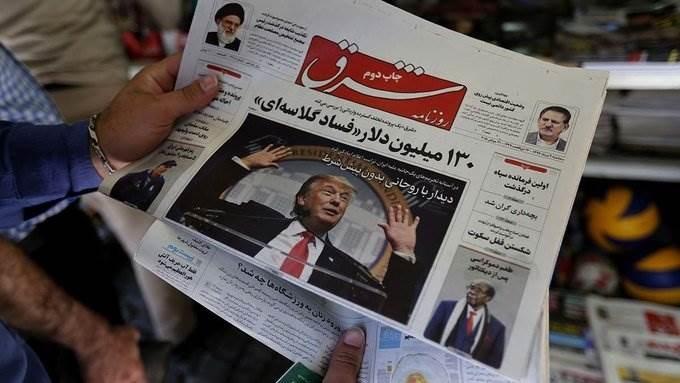 صحيفة إيرانية عليها صورة ترامب على الصفحات الأولى (أ ف ب).