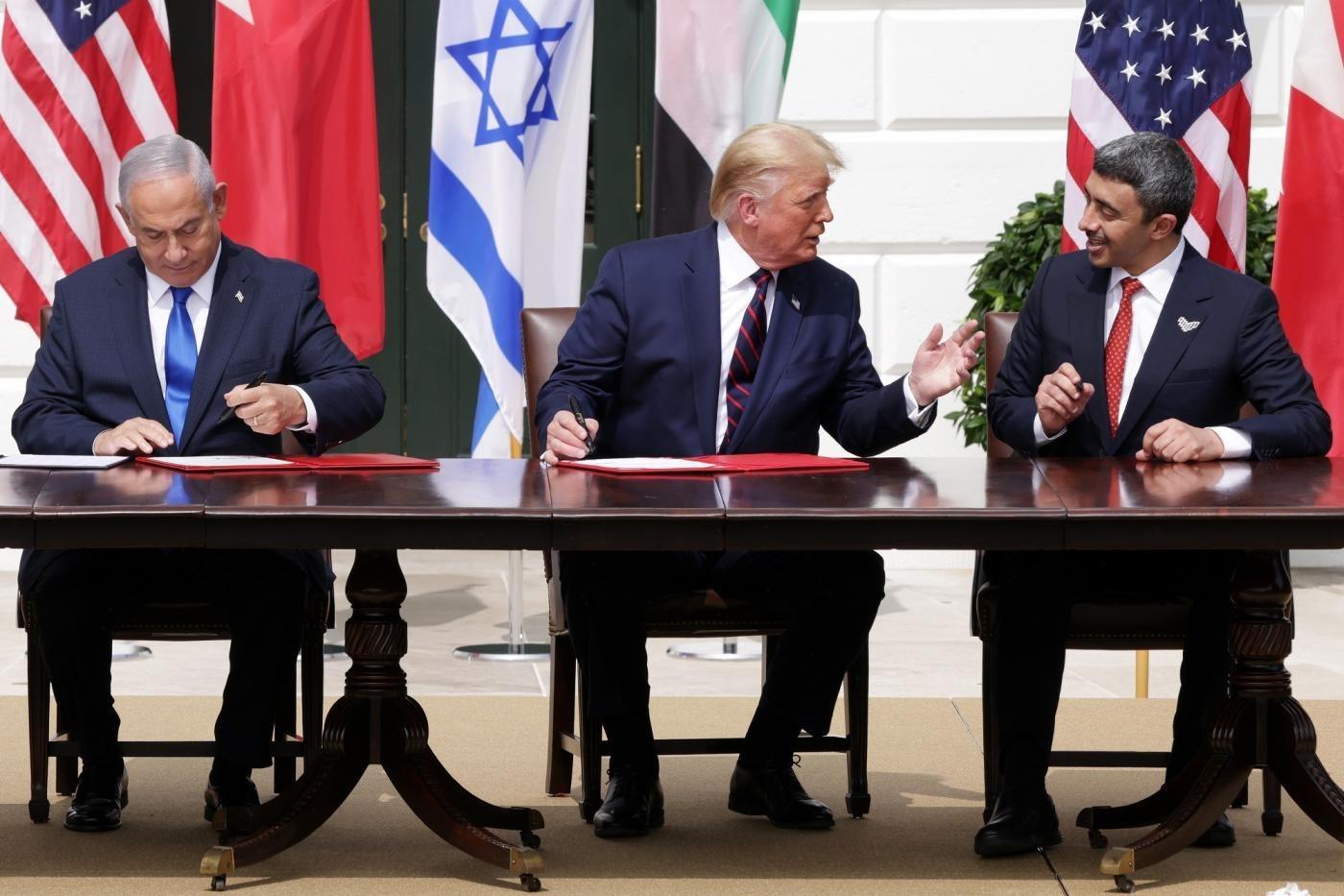 خلال مراسم توقيع اتفاقية التطبيع الإماراتي الإسرائيلي في البيت الأبيض في أيلول/ سبتمبر 2020 (أ ف ب)
