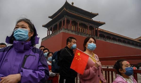 سياح في المدينة المحرمة في العاصمة الصينية بكين.