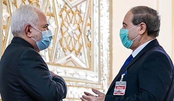 وزير الخارجية الإيراني مستقبلاً نظيره السوري في طهران