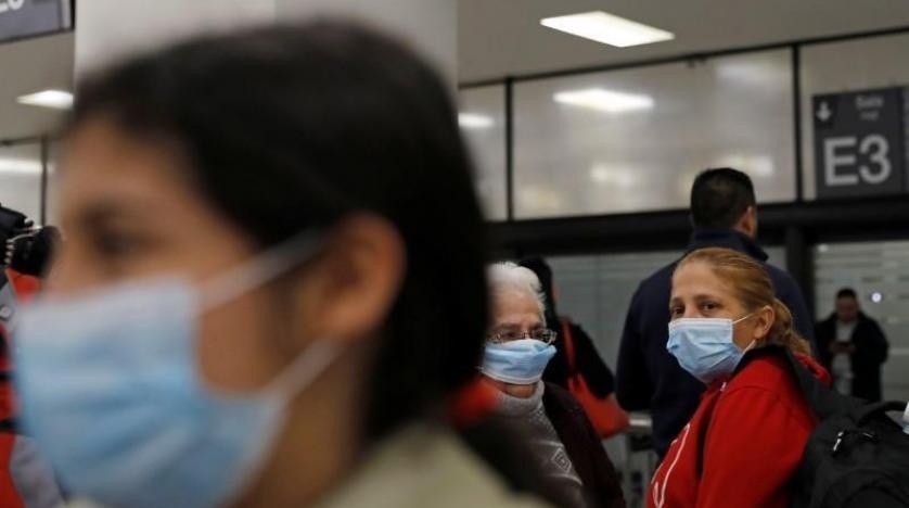 """""""الغارديان"""" تتساءل..  طلب الحكومة البريطانية من رعاياها مغادرة الصين سياسي أو طبي؟"""