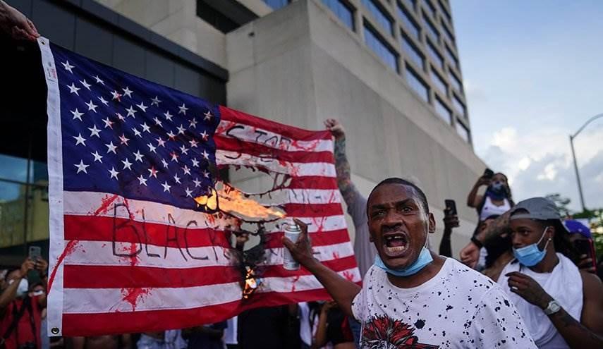 """""""لا عدالة لا سلام"""".. تظاهرات حول العالم ضد سياسة القمع الأميركية"""