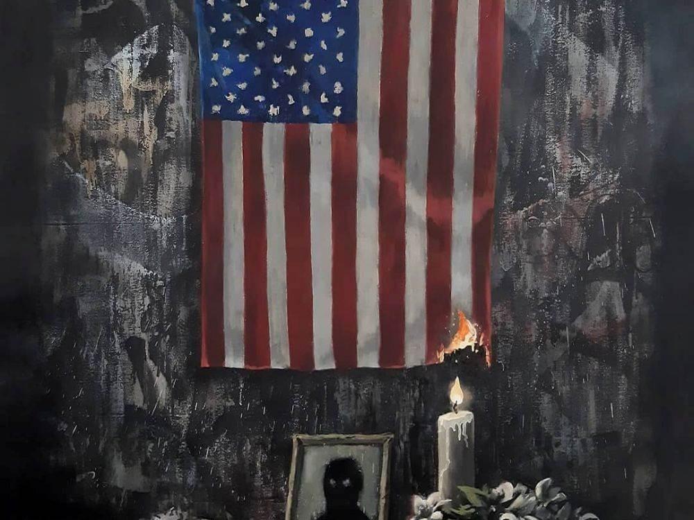 """رسم جديد لـ""""بانكسي"""".. شمعة الملونين تحرق أميركا"""