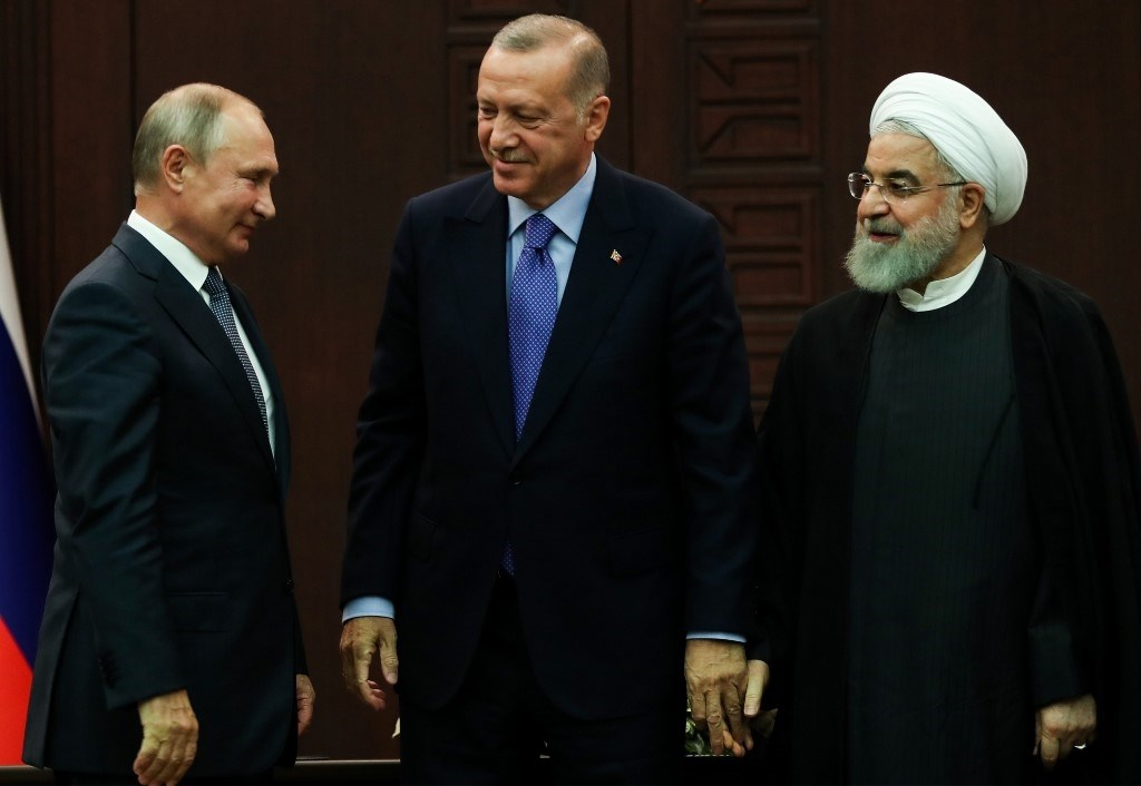 روحاني، إردوغان وبوتين خلال لقائهم حول سوريا في سبتمبر الماضي (أ.ف.ب)