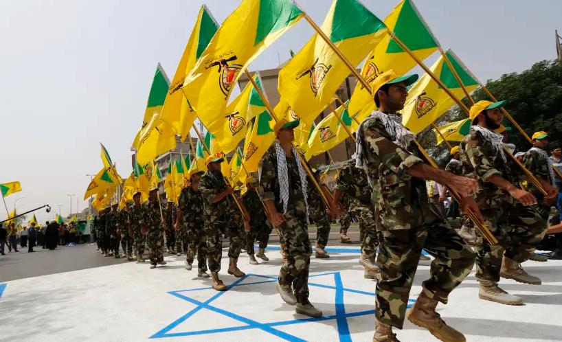 عرض عسكري لكتائب حزب الله العراق في يوم القدس العالمي (رويترز)