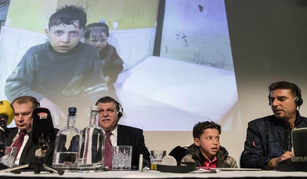 مؤتمر صحفي في لاهاي عام 2018 حول استخدام الأسلحة الكيميائية في سوريا (أ ف ب).