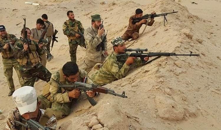 قوات من الحشد الشعبي تصدّ هجوماً لداعش في قرية المبارك (صورة أرشيفية).