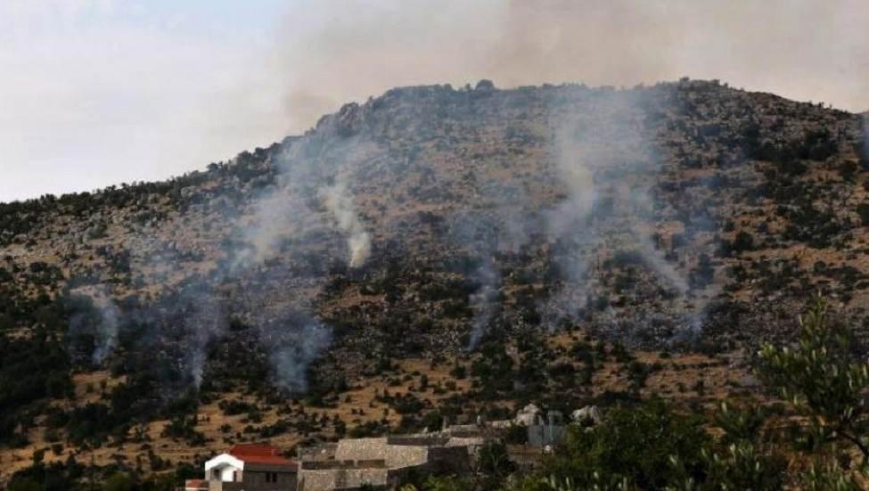 دخان يتصاعد جراء حريق نجم عن قصف المدفعية الإسرائيلية محيط بلدة كفرشوبا جنوب لبنان