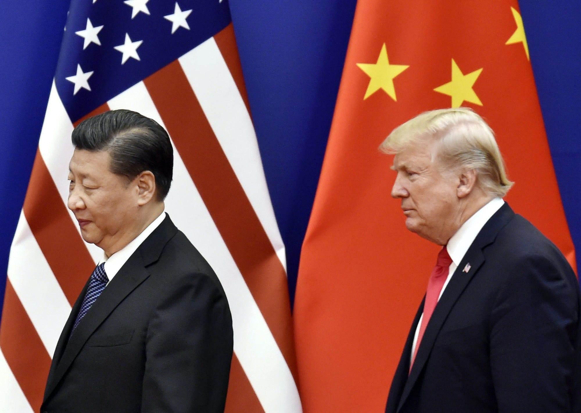 الرئيس الأميركي دونالد ترامب والرئيس الصيني شي جين بينغ خلال لقاء لهما (Getty Images)