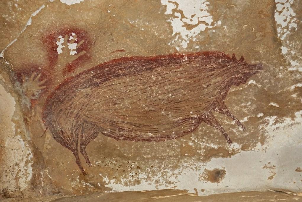 صورة لأقدم لوحة صخرية في العالم