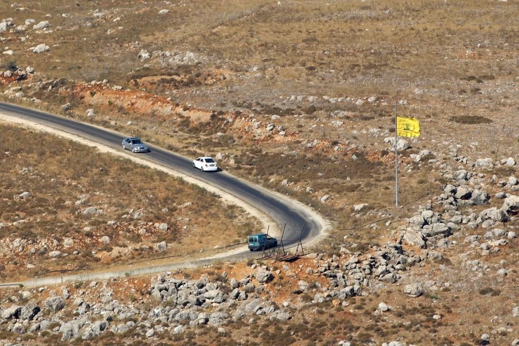 علم حزب الله على الحدود اللبنانية مع فلسطين المحتلة - 14 يوليو 2020 (أ.ف.ب)