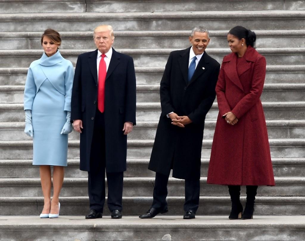 ترامب وميلانيا برفقة أوباما وميشيل في الكابيتول بعد مراسم التنصيب في 20 يناير 2017 (أ.ف.ب)