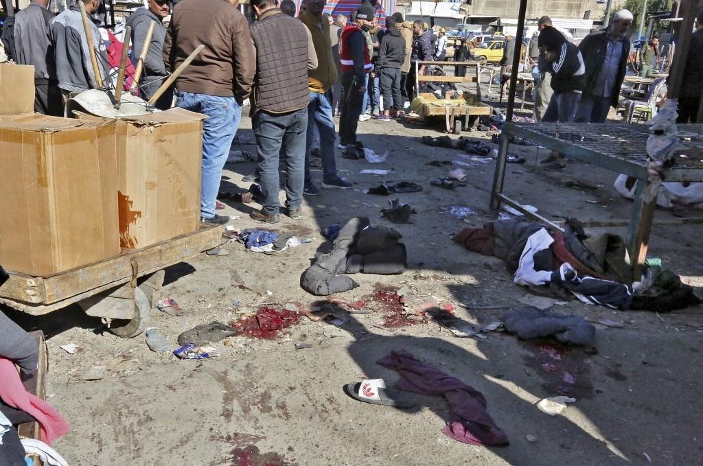 تفجير انتحاري مزدوج وسد بغداد في 21 كانون الثاني/ يناير (أ ف ب)
