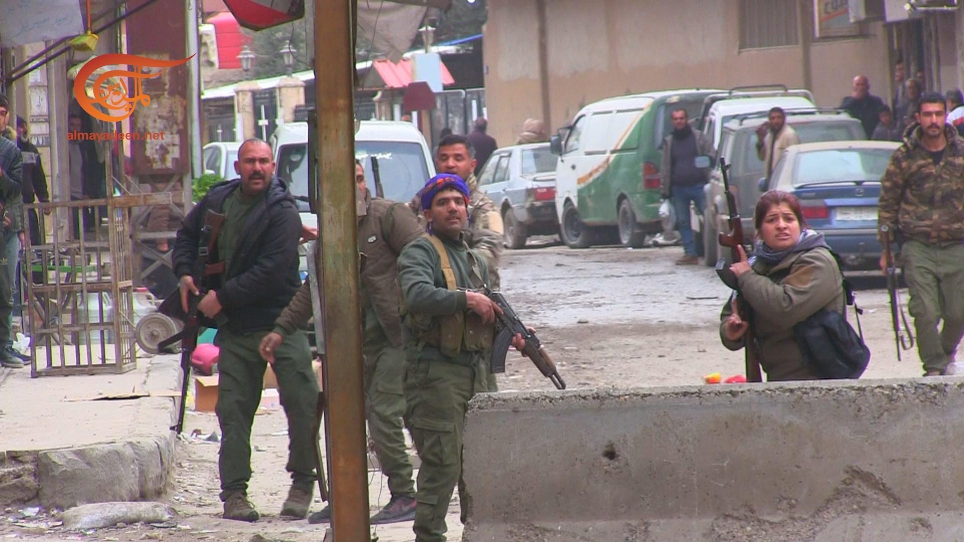 صور تظهر مسلحي قسد يطلقون النار على المتظاهرين