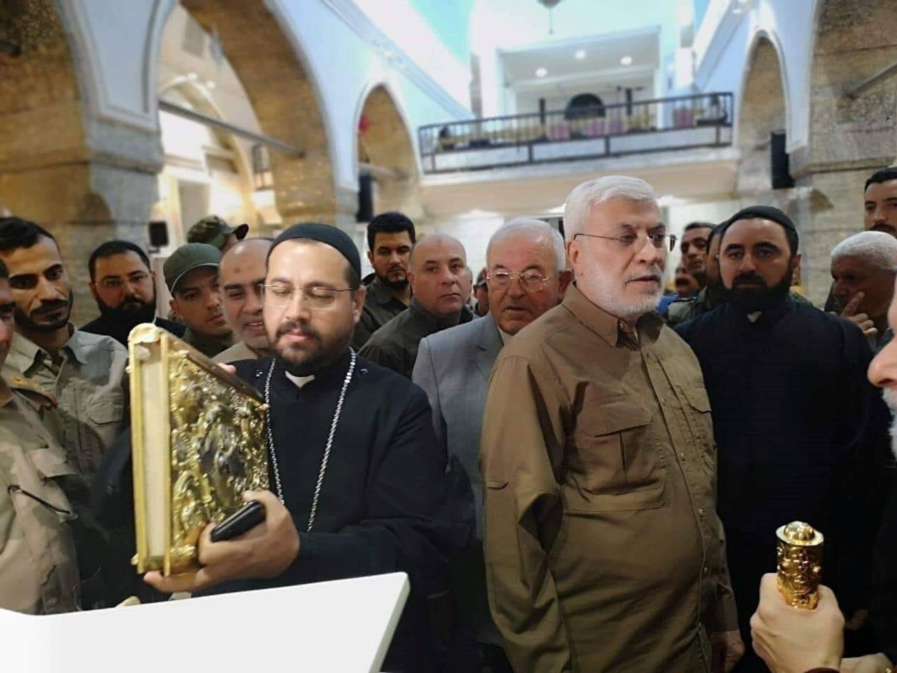 من زيارة الشهيد أبو مهدي المهندس إلى كنيسة مارت شموني في 7 آب/اغسطس عام 2019.