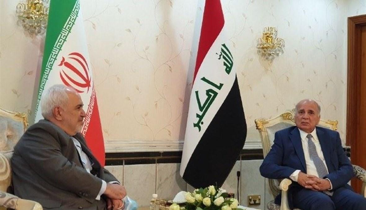 وزير الخارجية الإيراني محمد جواد ظريف ونظيره العراقي فؤاد حسين