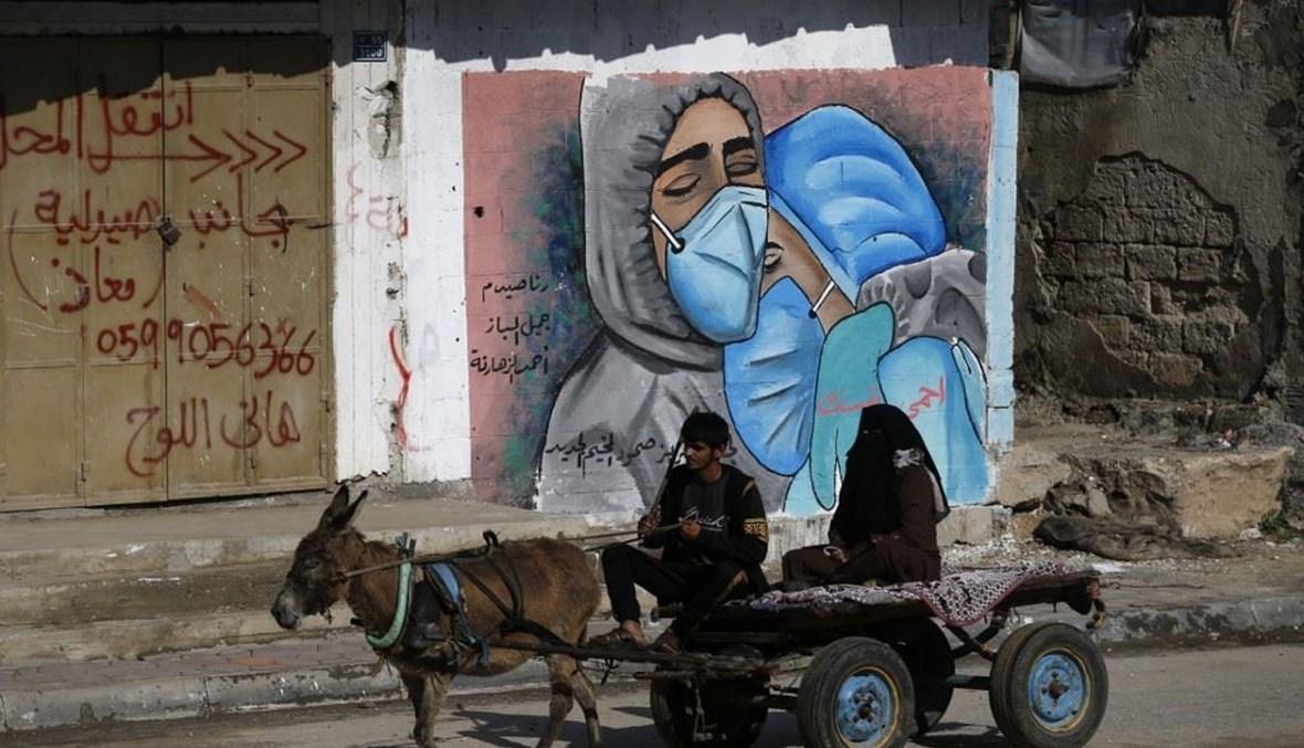 جدارية لدعم القطاع الطبي في غزة (أ ف ب).