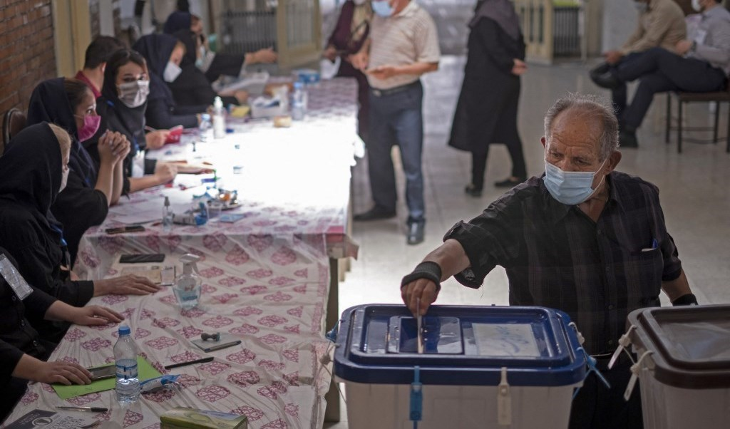 A citizen casts his vote in the Iranian presidential elections (AFP)