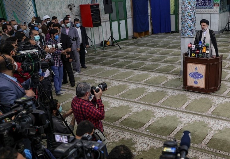 Raisi holds a press conference at a polling station in Tehran - June 18 (AFP).