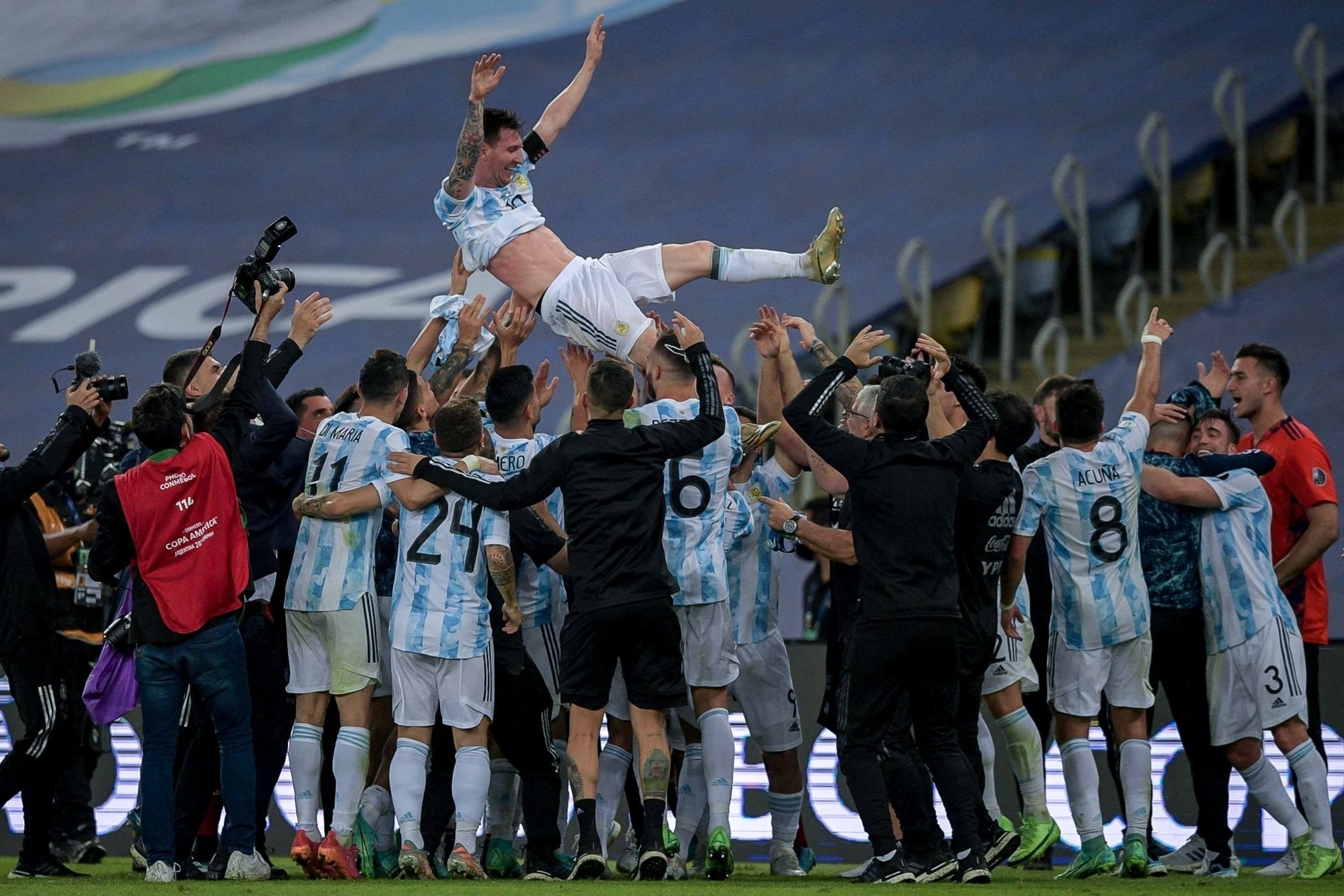 Argentina's Lionel Messi and teammates rejoice winning the Copa America