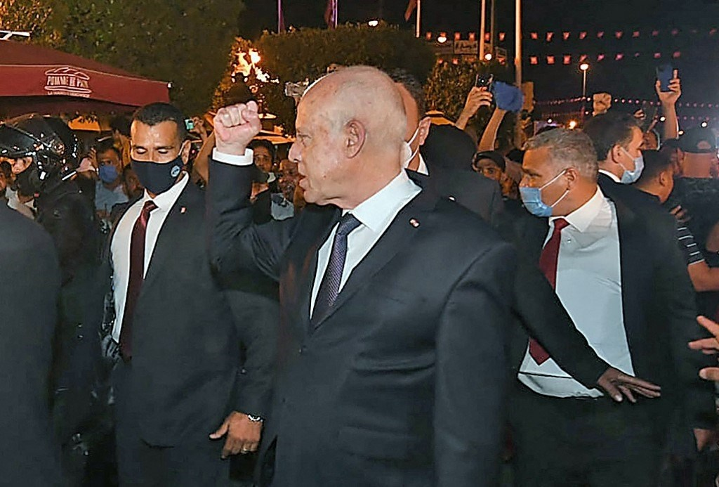 Tunisian President Kais Saied tours Habib Bourguiba Street amid intense security and military reinforcements on July 25, 2021 (AFP)
