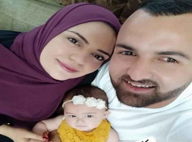 Anhar al-Deek with her husband and baby girl