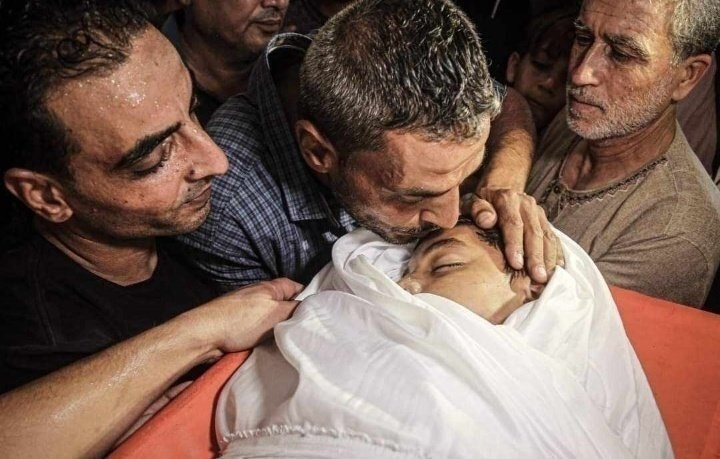 Omar Hassan Abu al-Nil, the child martyr, embraced by his family one last time