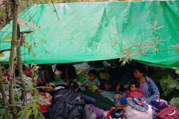 Villagers hide in bush after fleeing Myanmar army attack in Kalay district